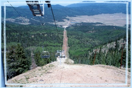 View of Angel Fire Ski Area high-speed quad chairlift.